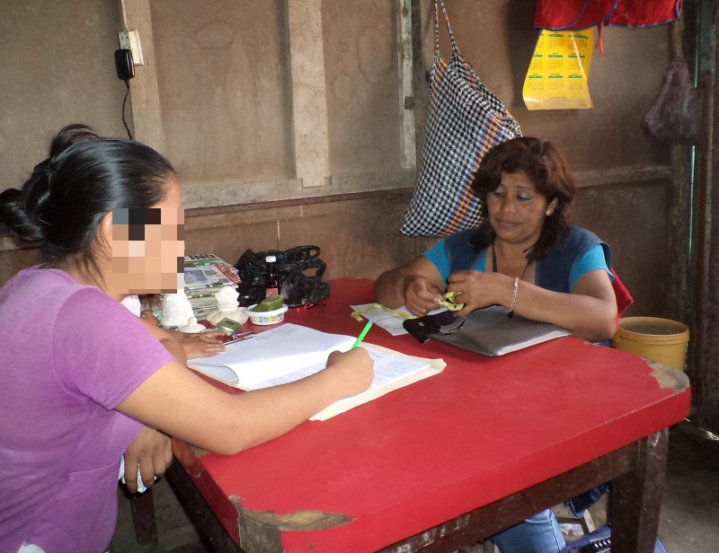 One of the project nurses meeting with a patient in their home.